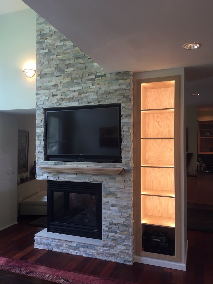 JR Carpentry & Tile installed a three-sided ledger stone fireplace in a Southampton home that can be enjoyed from all angles.